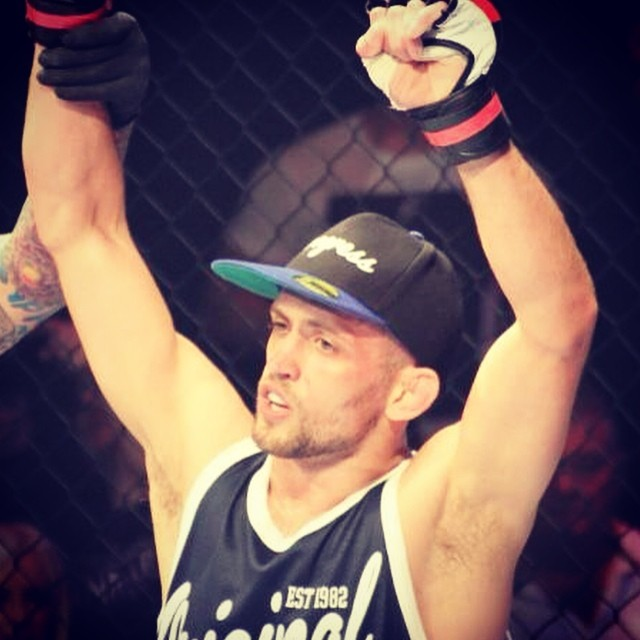 Pietro Menga, hands raised after his BAMMA victory