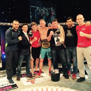 Current FCC Lightweight Champion Tim and the team